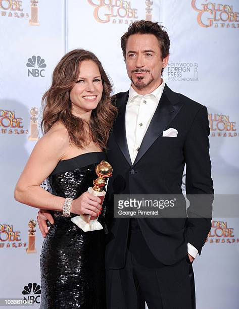 Producer Susan Downey and husband actor Robert Downey Jr pose in the press room at the 67th Annual Golden Globe Awards at The Beverly Hilton Hotel on...
