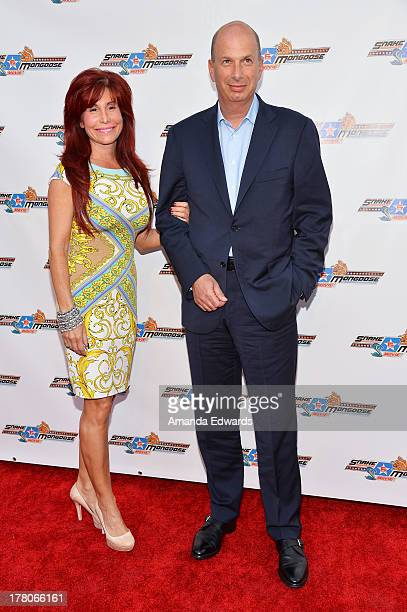 Producer Suzanne DeLaurentiis and Gordon Sondland arrive at the premiere of Snake Mongoo$e at the Egyptian Theatre on August 26 2013 in Hollywood...