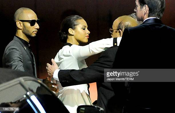 Producer Swizz Beatz singer Alicia Keys and Chief Creative Officer of Sony Music Entertainment Clive Davis arrive at the Clive Davis and The...