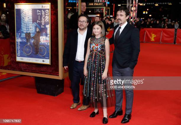 Producer Teddy Schwarzman actress Anna Pniowsky and US actor and director Casey Affleck walk over the red carpet as they arrive for the premiere of...