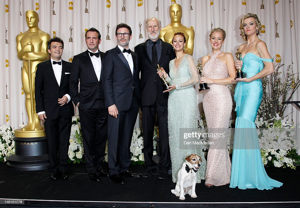 Producer Thomas Langmann, actor Jean Dujardin, director Michel Hazanavicius, actors James Cromwell, Berenice Bejo, Uggie the dog, Penelope Ann Miller, and Missi Pyle pose in the press room at the 84th Annual Academy Awards held at Hollywood & Highland Center on February 26, 2012 in Hollywood, California.