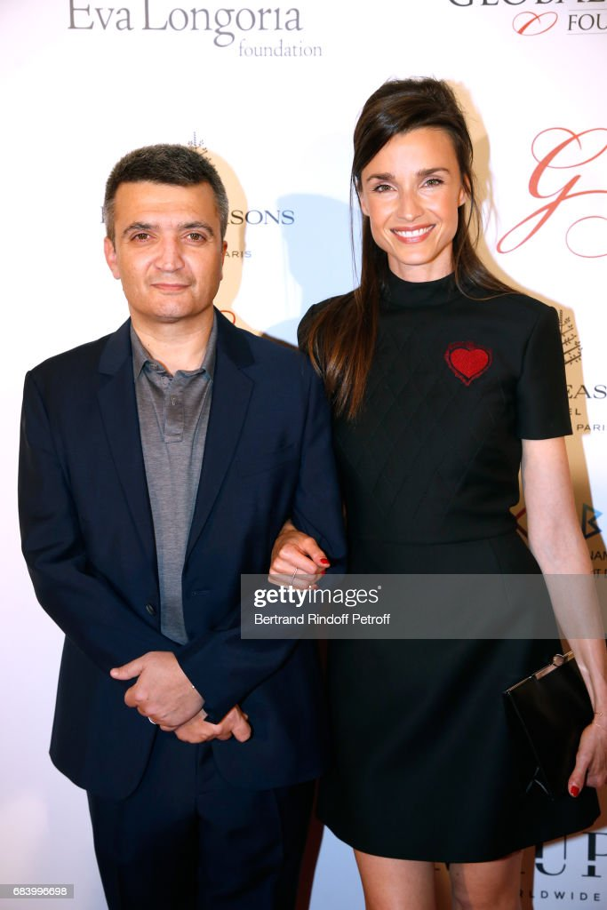 Producer Thomas Langmann and his wife Celine Bosquet attend the 'Global Gift, the Eva Foundation' Gala : Photocall at Hotel George V on May 16, 2017 in Paris, France.