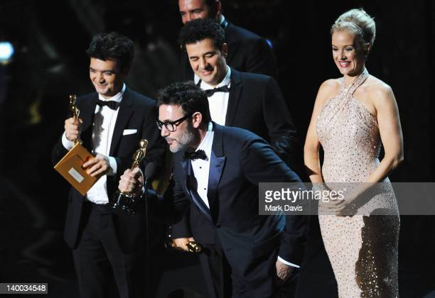 Producer Thomas Langmann Director Michel Hazanavicius actress Penelope Ann Miller and the cast of 'The Artist' accept award onstage during the 84th...