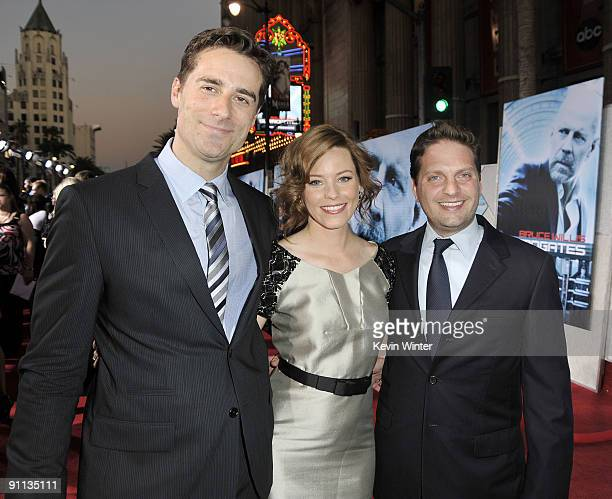 Producer Todd Lieberman executive producer/actress Elizabeth Banks and her husband producer Max Handelman arrive at the premiere of Touchstone...