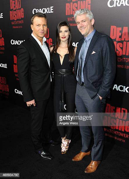 Producer Tomas Harlan actress Meghan Ory and Executive Producer Tim Carter arrive at the premiere of Crackle's 'Dead Rising Watchtower' at Sony...