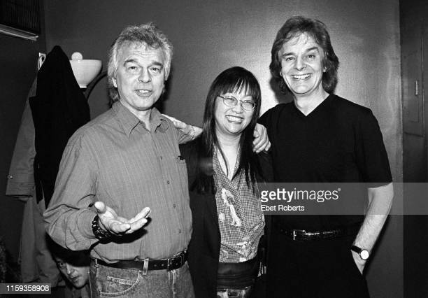 Producer Tony Visconti with his wife May Pang and Colin Blunstone of The Zombies backstage at The Fez in New York City on February 14, 1999.