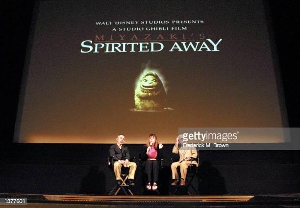 Producer Toshio Suzuki a language interpreter and director Hayao Miyazaki speak during a press conference and screening of the film 'Spirited Away'...