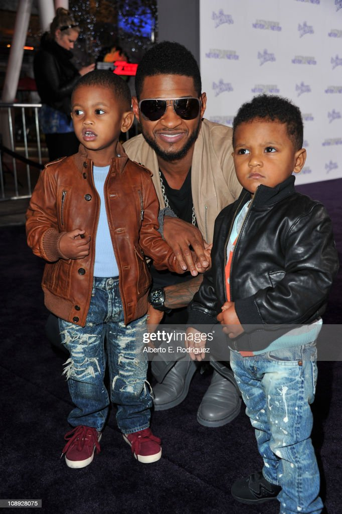 Producer Usher (C) and kids arrive at the premiere of Paramount Pictures' 'Justin Bieber: Never Say Never' held at Nokia Theater L.A. Live on February 8, 2011 in Los Angeles, California.