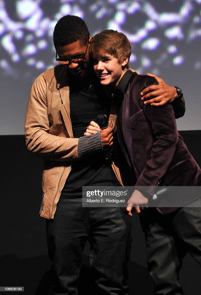 Producer Usher, and singer Justin Bieber speak onstage at the premiere of Paramount Pictures' 'Justin Bieber: Never Say Never' held at Nokia Theater L.A. Live on February 8, 2011 in Los Angeles, California.
