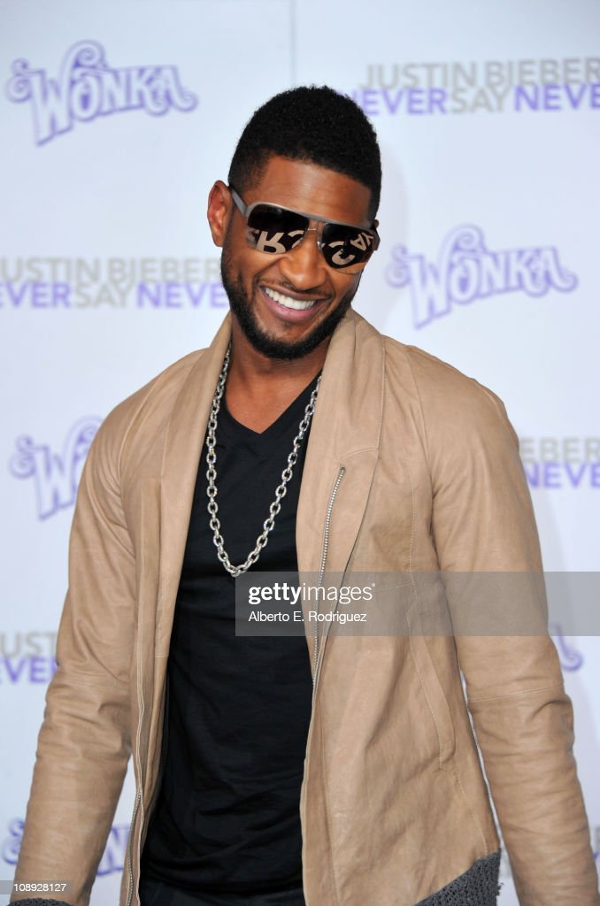 Producer Usher arrives at the premiere of Paramount Pictures' 'Justin Bieber: Never Say Never' held at Nokia Theater L.A. Live on February 8, 2011 in Los Angeles, California.