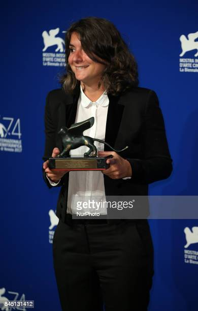 Producer Valentina Novati poses with the Special Orizzonti Jury Prize Award for 'Caniba' on behalf of Verena Paravel at the Award Winners photocall...