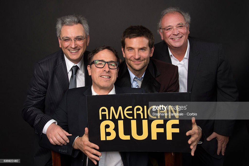 Producer Victor Hadida, Director David O. Russell, Actor Bradley Cooper and Producer Samuel Hadida pose at a photo session during the 'American Bluff' Party at Pavillon Champs Elysees, in Paris.