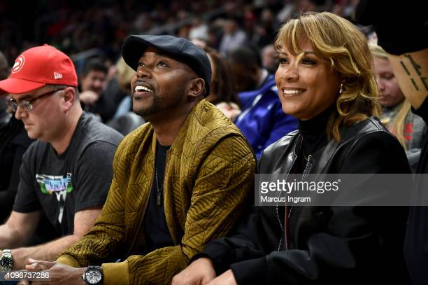 Producer Will Packer and Heather Hayslett Packer attend Atlanta Hawks Vs Boston Celtics game in partnership with 'What Men Want' at State Farm Arena...