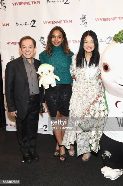 Producer William Kong Alisha Boe desiger Vivienne Tam and Wuba pose backstage for Vivienne Tam fashion show during New York Fashion Week The Shows at...