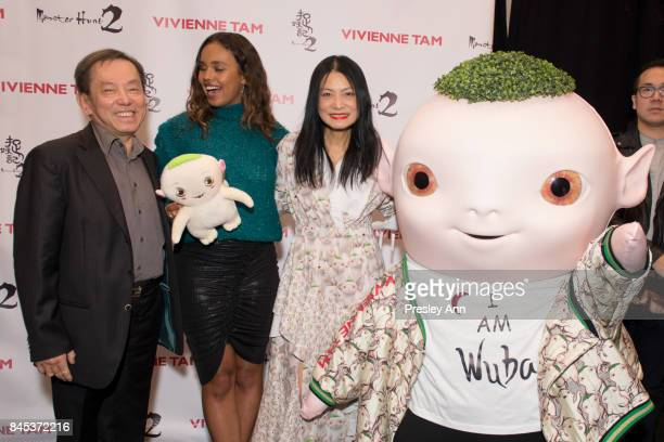 Producer William Kong Alisha Boe designer Vivienne Tam and Wuba pose backstage at the Vivienne Tam SS 2018 Runway Show at Gallery 1 Skylight Clarkson...