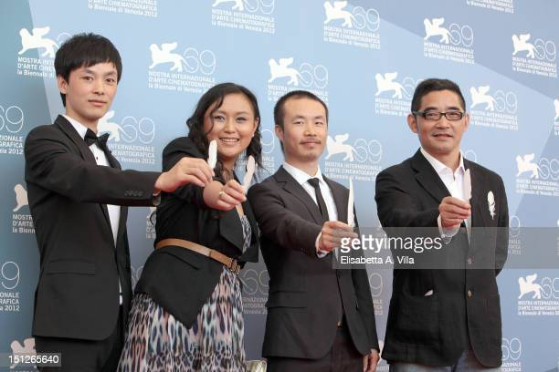 Producer Yang Cheng actress Zhang Shu Min director Li Ruijun and author Su Tong attend the 'Fly With The Crane' Photocall during the 69th Venice Film...