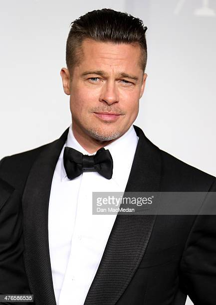 Producer/actor Brad Pitt winner of Best Picture for '12 Years a Slave' poses in the press room at the 86th Annual Academy Awards at Hollywood...