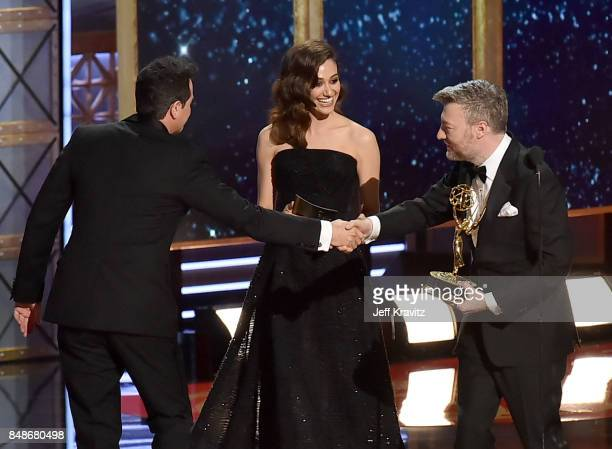 Producer/actor Seth MacFarlane and actor Emmy Rossum present writer Charlie Brooker with the Outstanding Writing for a Limited Series Movie or...