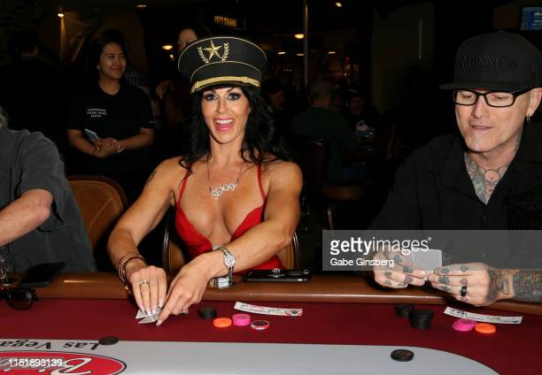Producer/choreographer Jennifer Romas and television personality/tattoo artist Dirk Vermin play Texas Hold'em during the Mike Hammer Celebrity Poker...
