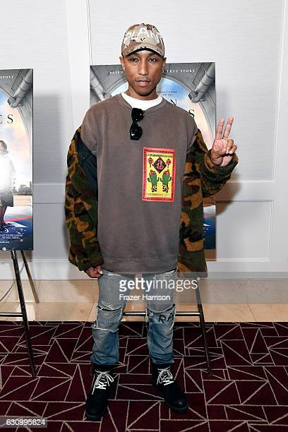 """Producer/Composer Pharrell Williams attends the Screening and Q&A for 20th Century Fox's """"Hidden Figures"""" at The London West Hollywood on January 4,..."""