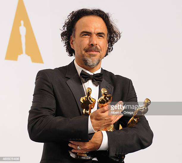 Producer/director Alejandro G Inarritu winner of Best Original Screenplay Best Director and Best Motion Picture for 'Birdman' poses inside the press...
