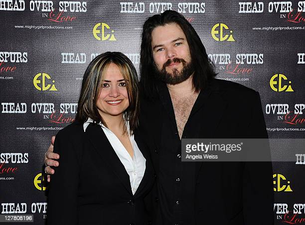 Producer/director Ana Zins and actor Chip Joslin arrive at the world premiere of 'Head Over Spurs In Love' at Majestic Crest Theatre on March 24,...