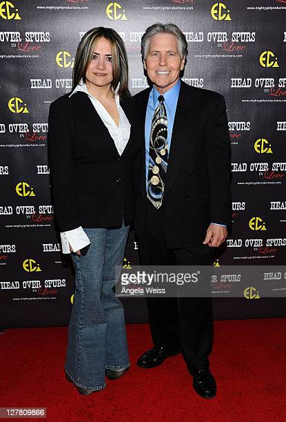 Producer/director Ana Zins and Charles Ruben arrive at the world premiere of 'Head Over Spurs In Love' at Majestic Crest Theatre on March 24, 2011 in...