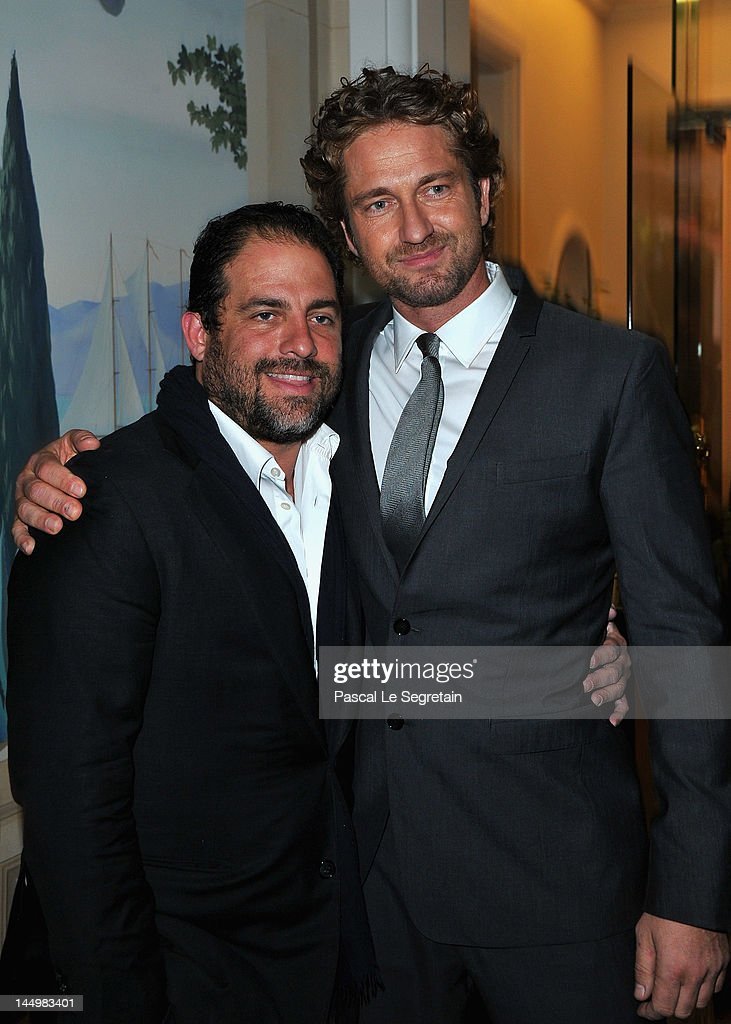 Producer/director Brett Ratner (L) and actor Gerard Butler attend the exclusive Filmmakers Dinner during the Cannes International Film Festival hosted by Swiss watch manufacturer IWC Schaffhausen in partnership with Finch's Quarterly Review at the famous Hotel du Cap-Eden-Roc on May 21, 2012 in Cap d'Antibes, France.