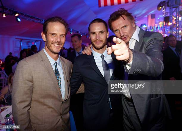 Producer/director Peter Berg actors Taylor Kitsch and Liam Neeson pose at the after party for the premiere of Universal Pictures' Battleship at LA...