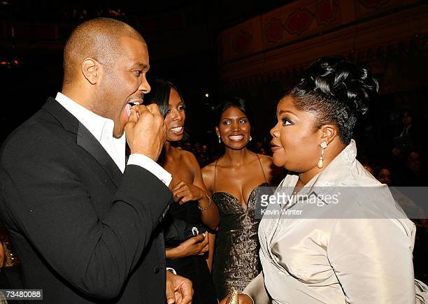 Producer/director/actor Tyler Perry and comedian Mo'Nique talk in the audience during the 38th annual NAACP Image Awards held at the Shrine...