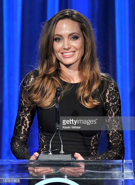 Producer/director/writer Angelina Jolie accepts the The Stanley Kramer Award onstage during the 23rd annual Producers Guild Awards at The Beverly...