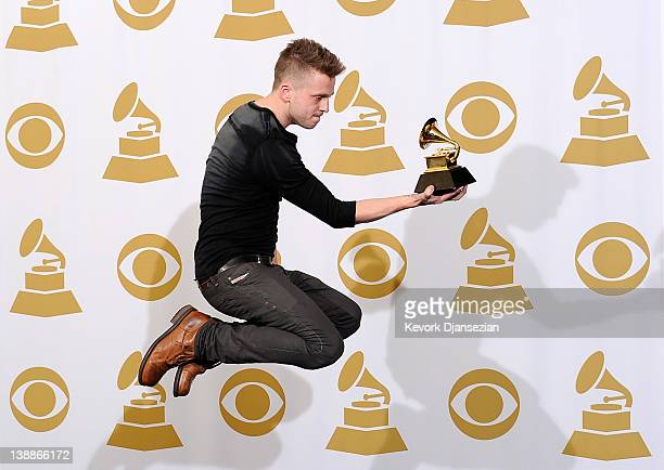 Producer/engineer Ryan Tedder winner of the GRAMMY for Album of the Year for 21 poses in the press room at the 54th Annual GRAMMY Awards at Staples...