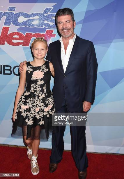 Producer-entrepreneur-philanthropist Simon Cowell and ventriloquist-singer Darci Lynne Farmer attend NBC's 'America's Got Talent' Season 12 Finale at...