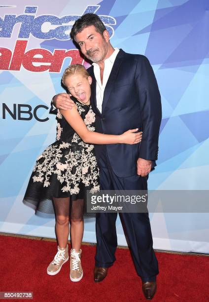 Producerentrepreneurphilanthropist Simon Cowell and ventriloquistsinger Darci Lynne Farmer attend NBC's 'America's Got Talent' Season 12 Finale at...