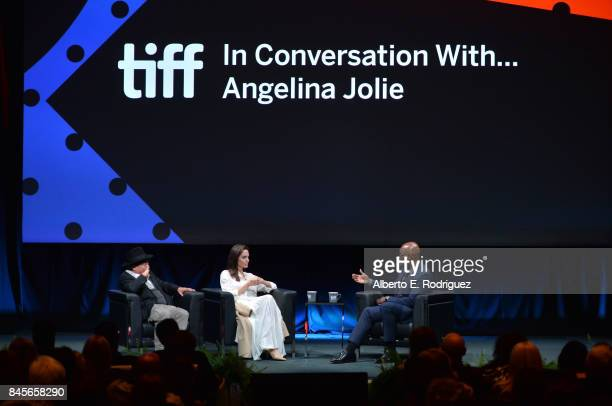 Producer/filmmaker Rithy Panh Director Angelina Jolie and Director of the Toronto International Film Festival Cameron Bailey speak onstage at the In...
