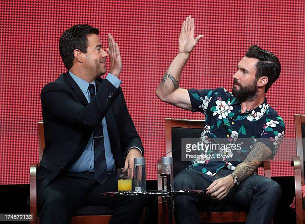 Producer/Host Carson Daly and coach Adam Levine speak onstage during 'The Voice' panel discussion at the NBC portion of the 2013 Summer Television...