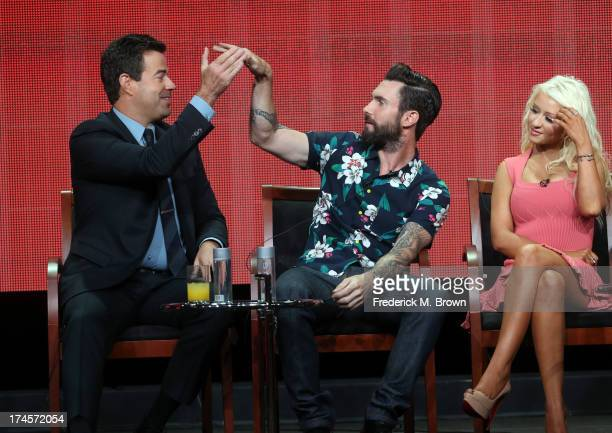 Producer/Host Carson Daly and coaches Adam Levine and Christina Aguilera speak onstage during 'The Voice' panel discussion at the NBC portion of the...