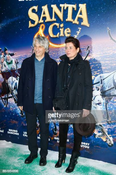Producers Alain Goldman and Sidonie Dumas Seydoux attend 'Santa Cie' Paris Premiere at Cinema Pathe Beaugrenelle on December 3 2017 in Paris France