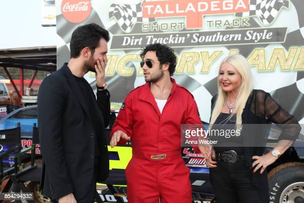 Producers and founders of AMBI Media Group Andrea Iervolino and Monika Bacardi pose with actor Toby Sebastian On The Set Of The Movie Trading Paint...