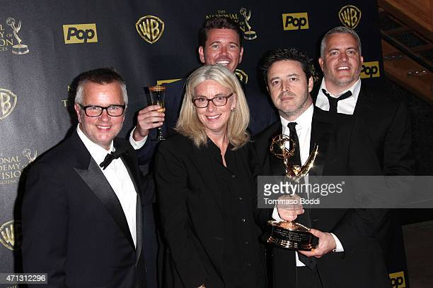 Producers Andy Lassner Ed Glavin Mary Connelly Kevin Leman and Jonathan Norman pose in the Press Room during the 42nd Annual Daytime Emmy Awards at...