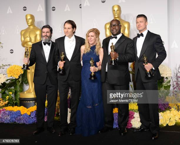 Producers Anthony Katagas Jeremy Kleiner Dede Gardner Brad Pitt and director Steve McQueen winners of Best Picture for 12 Years a Slave pose in the...