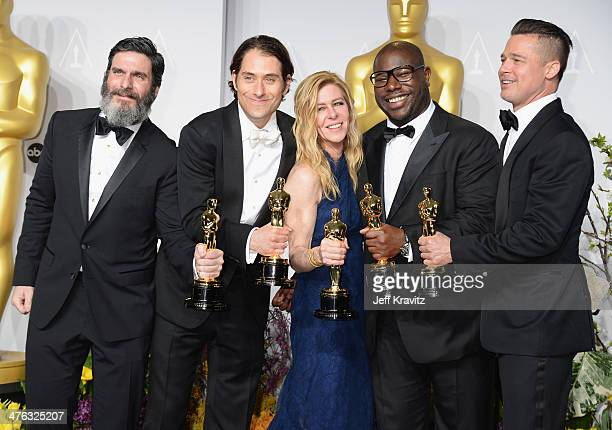 Producers Anthony Katagas Jeremy Kleiner Dede Gardner Steve McQueen and Brad Pitt pose in the press room during the Oscars at Loews Hollywood Hotel...