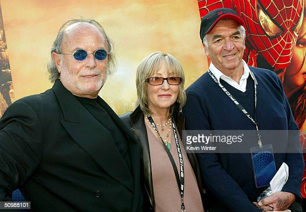 Producers Avi Arad Laura Ziskin and writer Alvin Sargent attend the premiere of the Sony film SpiderMan 2 on June 22 2004 at the Mann Village Theater...