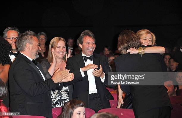 Producers Bill Pohlad and Dede Gardner hug after winning the Palme D'Or for The Tree of Life at the Closing Ceremony at the Palais des Festivals...