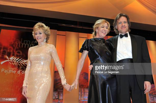 Producers Bill Pohlad and Dede Gardner of The Tree of Life with presenter Jane Fonda during the Closing Ceremony at the Palais des Festivals during...
