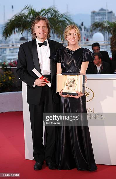 Producers Bill Pohlad and Dede Gardner pose with the Palme d'Or for 'The Tree of Life' at the Palme d'Or Winners Photocall at the Palais des...