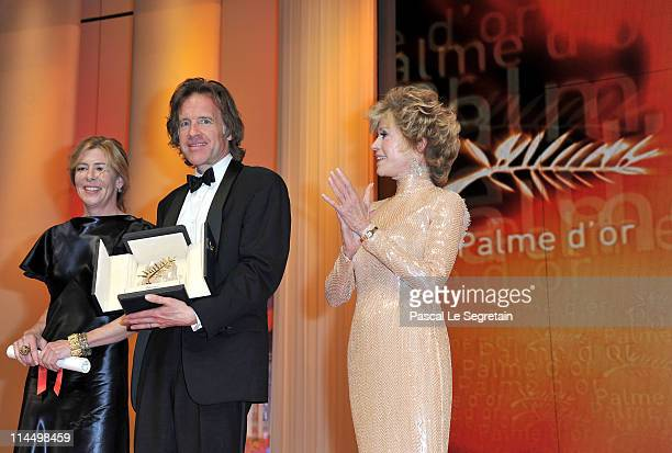 Producers Bill Pohlad and Dede Gardner with the Palme d'Or for The Tree of Life with presenter Jane Fonda attends the Closing Ceremony at the Palais...