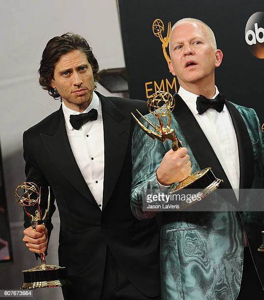 Producers Brad Falchuk and Ryan Murphy pose in the press room at the 68th annual Primetime Emmy Awards at Microsoft Theater on September 18 2016 in...