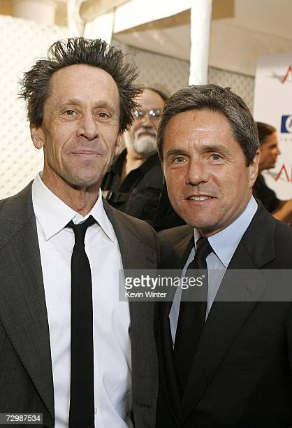 Producers Brian Grazer and Brad Grey pose for photos during the arrivals at the 7th Annual AFI Awards luncheon held at the Four Seasons Hotel on...