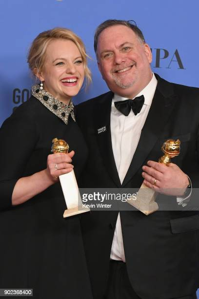 Producers Bruce Miller and Elisabeth Moss of 'The Handmaid's Tale' pose with their awards for Best Television Series Drama in the press room during...